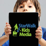 Boy peers over iPad with SWK Logo